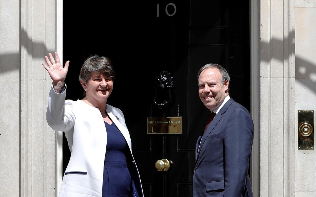The leader of the DUP, Arlene Foster, and the Deputy Leader Nigel Dodds, stand on the steps of No. 10 Downing Street before talks with Britain's Prime Minister Theresa May, in London on June 13, 2017. Photo: Reuters