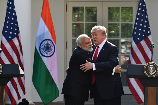 US President Donald Trump and Indian Prime Minister Narendra Modi embrace during a joint press conference in the Rose Garden at the White House in June. Photo: AFP / Nicholas Kamm