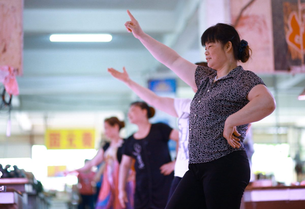 Vendors dance to exercise at a food market in the afternoon where there are less customers, in Nanning, Guangxi province, China. Photo: Reuters/Stringer