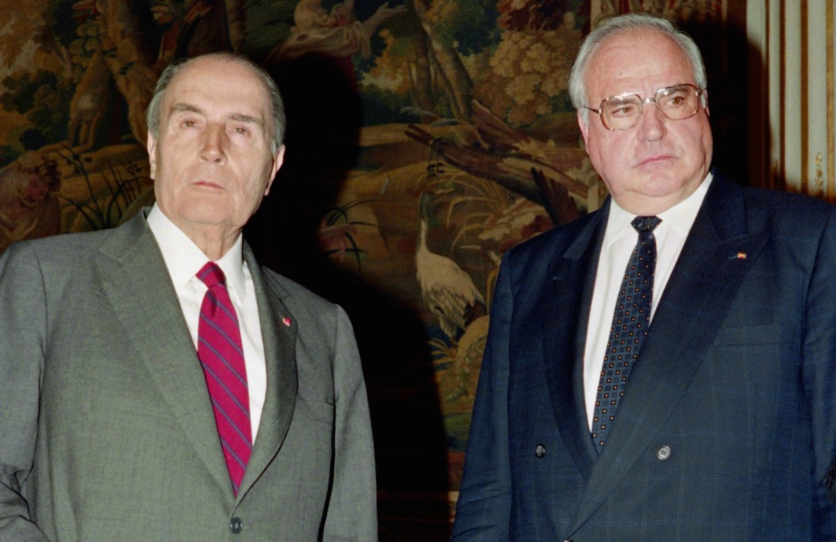 German Chancellor Helmut Kohl with French President Francois Mitterrand at the Elysee Palace in Paris in December 1991. A strong supporter of European integration, Kohl won the trust of Mitterrand and the friendship of Jacques Delors, then president of the European Commission and the architect of Europe's single market. Photo: AFP/Joel Robine