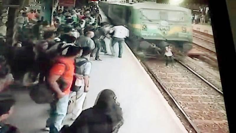Pratiksha Natekar walks along the tracks just before the train ran over her. Photo: The Free Press Journal