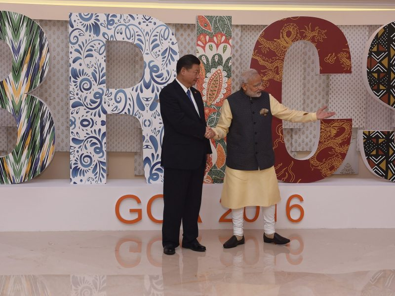 Shall we dance? Indian Prime Minister Narendra Modi (right) and China's President Xi Jinping greet one another prior to the BRICS Summit in Goa on October 16, 2016. Photo: AFP / Prakash Singh