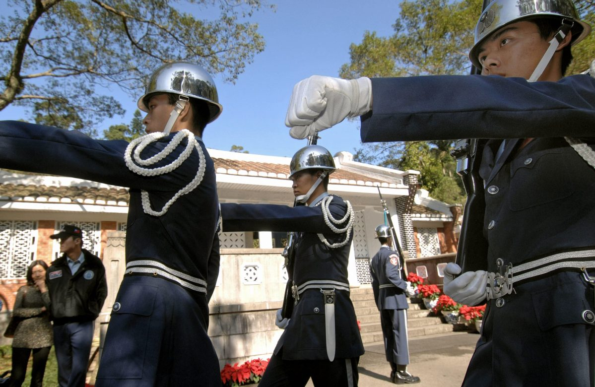 Honour guards perform as tourists look on outside the mausoleum of Taiwan's former ruler Chiang Kai-shek in Tahsi, Taoyuan county. Photo: AFP/Sam Yeh