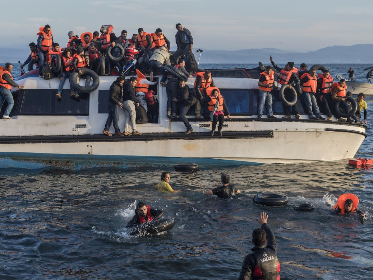 A boatload of Syrian and Iraqi refugees nears the Greek Island of Lesbos. The Syrian civil war highlights the global crisis involving refugees and migrants, a crisis the author believes requires a new international migration system that recognizes all types of population movement between countries. Photo: Ggia/Wikipedia Commons