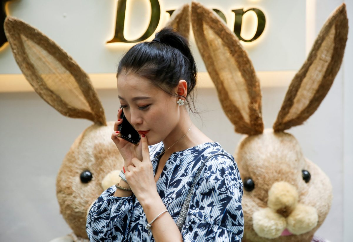 A woman talks on a mobile phone in Beijing, China June 3, 2017. Photo: Reuters/Thomas Peter