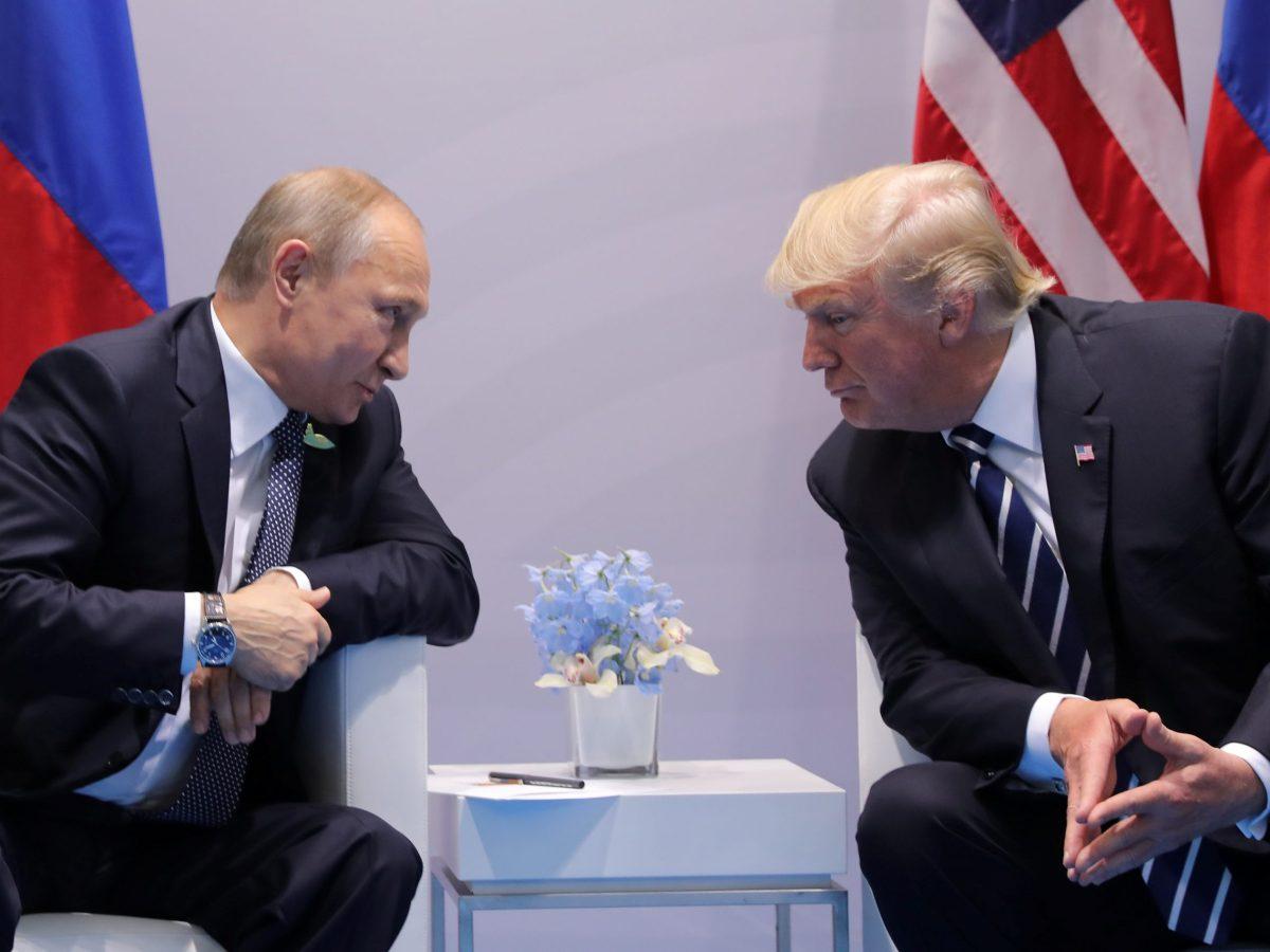 Russian President Vladimir Putin talks to US President Donald Trump at the G20 summit in Hamburg in July 2017. Photo: Carlos Barria/ Reuters