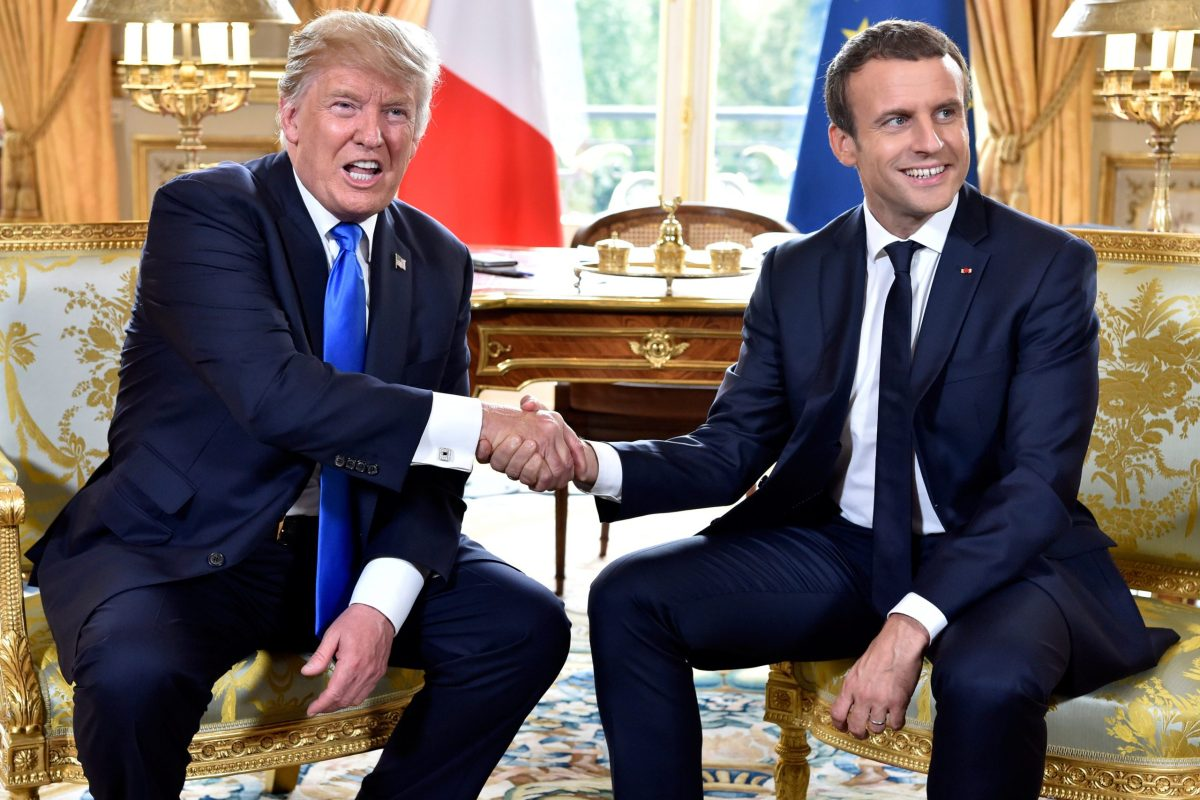 Donald Trump and Emmanuel Macron shake hands on July 13, 2017. Reuters / Alain Jocard
