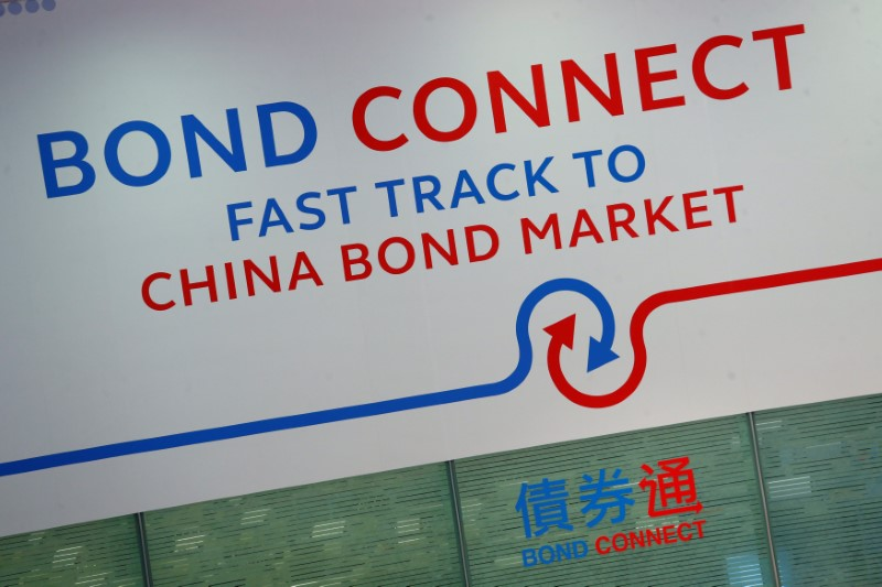 A backdrop displays the title of Bond Connect at Hong Kong Exchanges in Hong Kong, China. Photo: Reuters / Bobby Yip