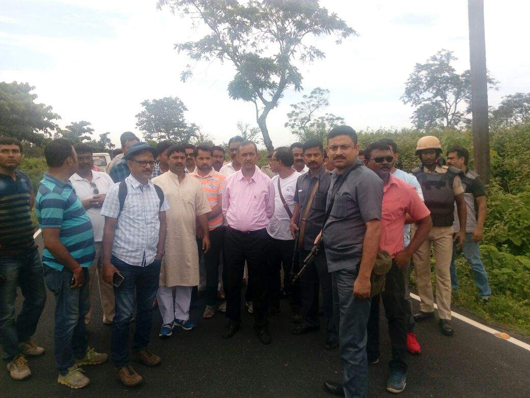 West Bengal Tourism Minister Goutam Deb with his security guards at the gates of Panighata in Darjeeling district on Wednesday. Photo: Express