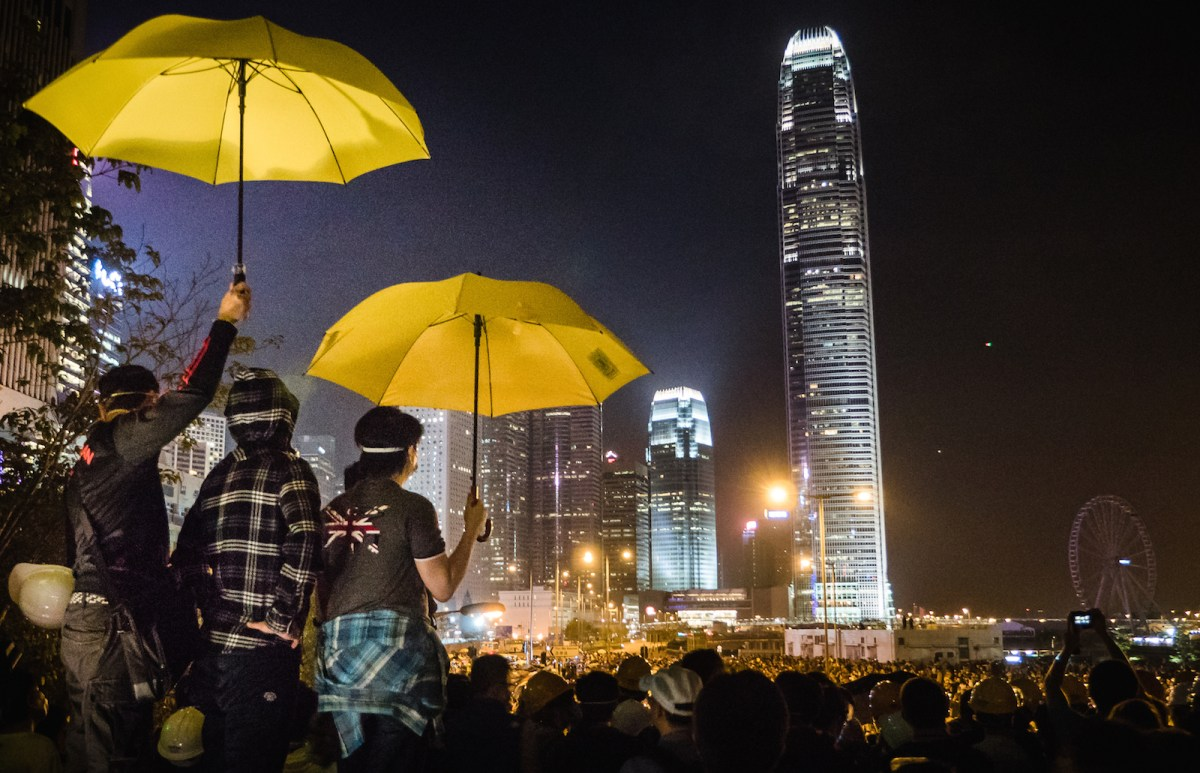 Umbrella Movement protesters in Hong Kong say Beijing is backpedaling on its so-called 'one country, two systems' political deal struck after the British colony was returned to China. The author suggests Western media reports on the protests fail to fairly portray both sides in the ongoing dispute and that this is a pervasive and potentially dangerous problem in reporting other global conflicts. Photo: Pasu Au Yeung/Wikipedia Commons.