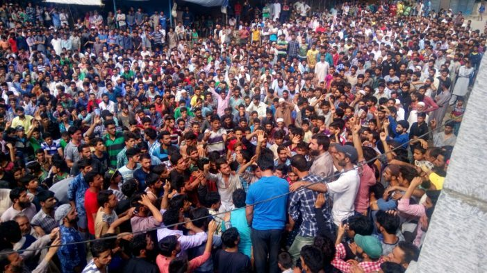 Thousands protest against the shooting death of Tanveer Ahmed Pala on Friday in central Kashmir's Budgam district. Photo: Kashmir Reader
