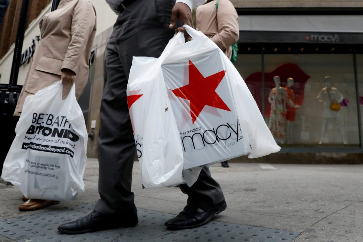 A customer exits after shopping at a Macy's store. Photo: Reuters/Brendan McDermid