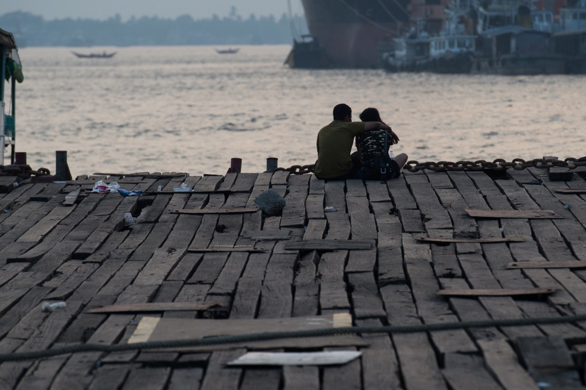 A decrepit jetty at sunset on the shores of Yangon, home to more than 90% of Myanmar's port capacity. Photo: AFP/Ye Aung Thu