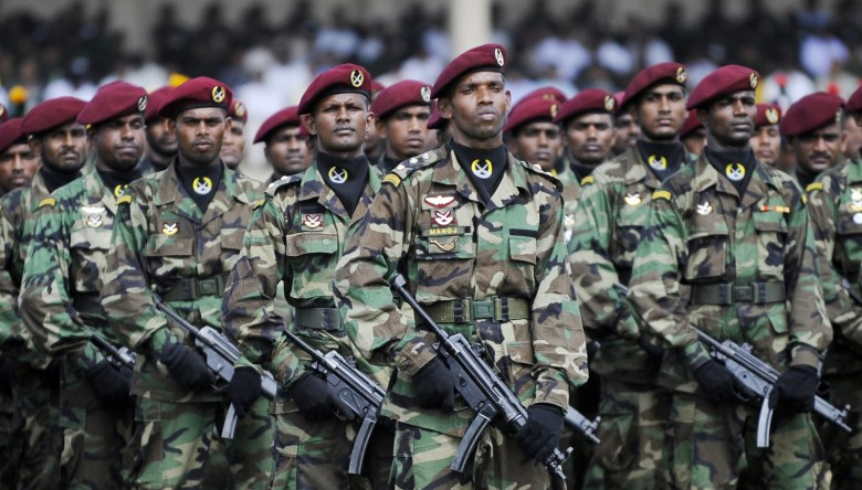 Sri Lankan special forces commandos take part in a military ceremony honouring 10 battlefield commanders who led the final push against the Liberation Tigers of Tamil Eelam (LTTE) rebels in Colombo on May 28, 2009. General Sarath Fonseka said the Tigers could carry out hit-and-run attacks, but did not have the ability to militarily regroup after their defeat that ended almost three decades of strife. AFP PHOTO/Ishara S. KODIKARA / AFP PHOTO / Ishara S. KODIKARA