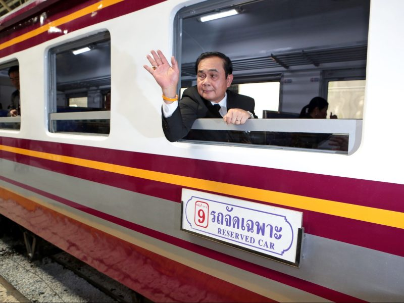 "Thai Prime Minister Prayut Chan-ocha takes a window seat on board a special train. A political foe to Yingluck, he has disavowed the ""rice-for-bullet train"" agreement with China. Photo: Bangkok Post via AFP/Chanat Katanyu"