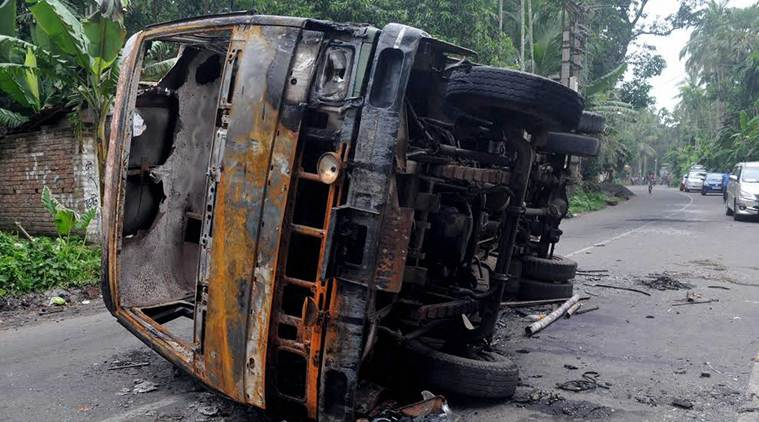 A burnt vehicle after a communal riot in Baduria in West Bengal on Wednesday. Photo: PTI
