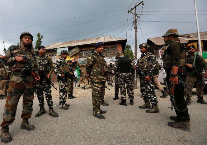 Indian security force personnel stand at the site of a gun battle between Indian police and militants on Monday in which seven Hindu pilgrims were killed in south Kashmir's Anantnag district. Photo: Reuters / Danish Ismail