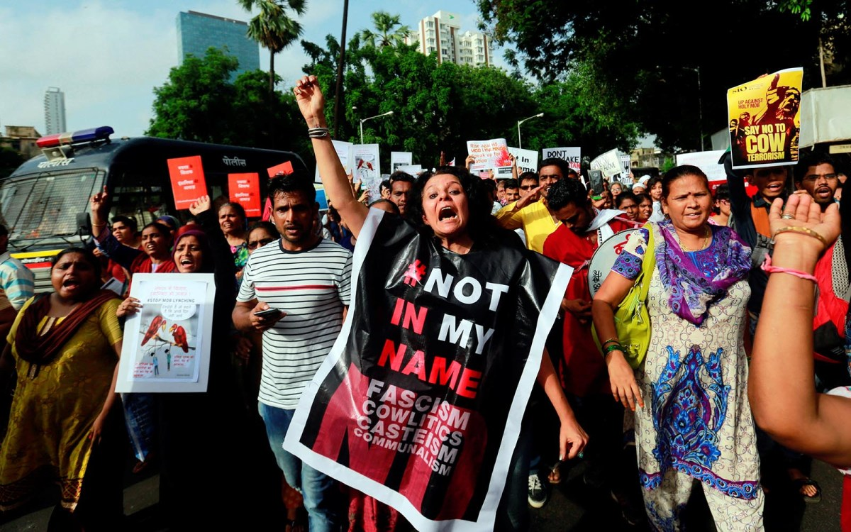 A woman shouts during a protest against the mob lynching of Muslims who were accused of possessing beef in Mumbai on July 3, 2017. Photo: Reuters/Danish Siddiqui