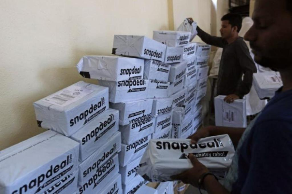 Snapdeal employees sort out delivery packages at their office in Mumbai _ Reuters