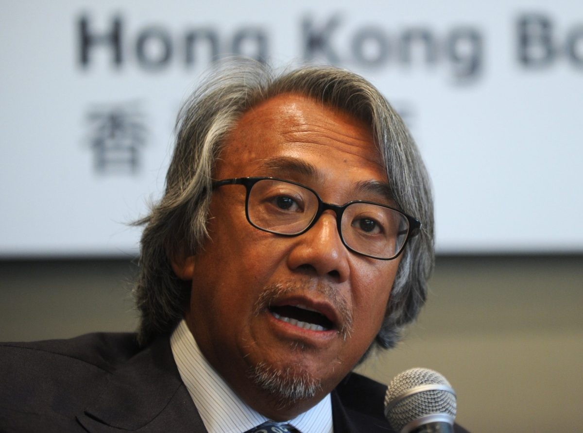Sir David Tang speaks at a press conference in Hong Kong on July 23, 2010. Photo: AFP