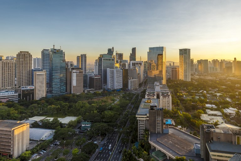 View of the Makati district in Manila at sunrise, Philippines. Photo: AFP