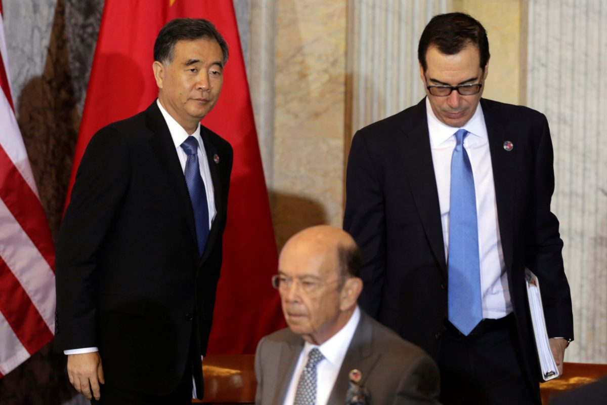 US Treasury Secretary Steve Mnuchin, Commerce Secretary Wilbur Ross and China's Vice Premier Wang Yang at the US - China Comprehensive Economic Dialogue in July. Photot Reuters/Yuri Gripas