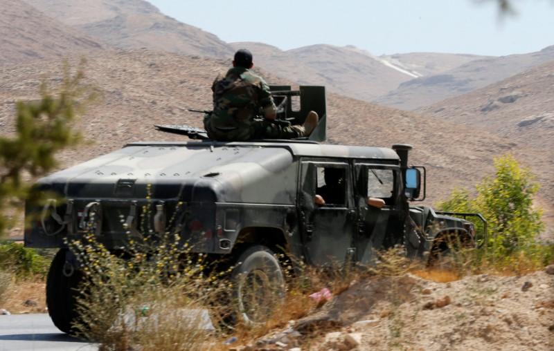 Lebanese army soldiers are seen inside a military vehicle in Labwe, at the entrance of the border town of Arsal, in eastern Bekaa Valley, Lebanon July 24, 2017. REUTERS/Mohamed Azakir