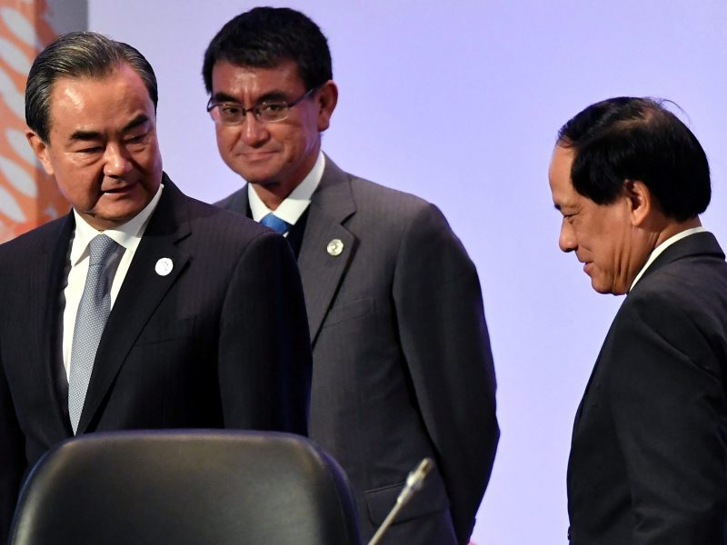 (L-R) China's Foreign Minister Wang Yi, Japan's Foreign Minister Taro Kono and ASEAN Secretary-General Le Luong Minh walk after a family photo before the 18th ASEAN Plus Three Foreign Ministers Meeting in Manila on August 7, 2017. Reuters/Mohd Rasfan/Pool
