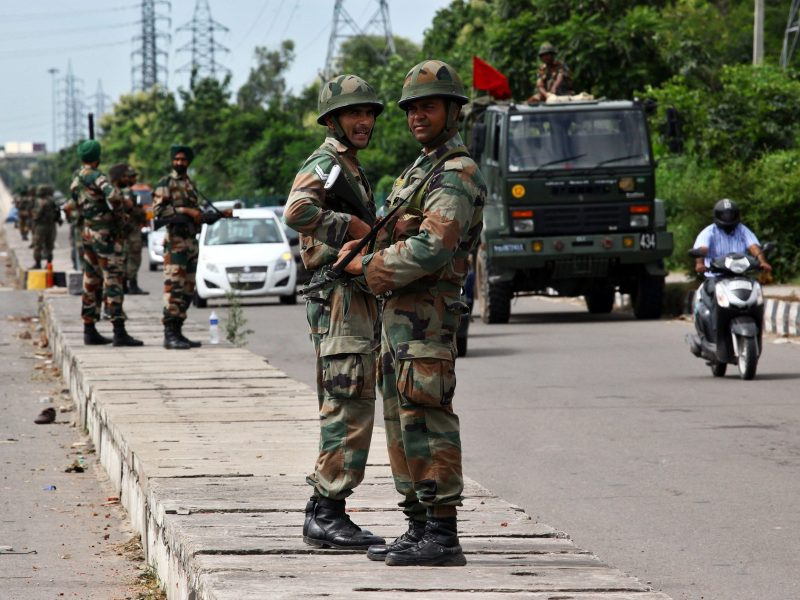Soldiers stood guard on a highway in Panchkula on Monday as Gurmeet Ram Rahim Singh was sentenced. Photo: Reuters