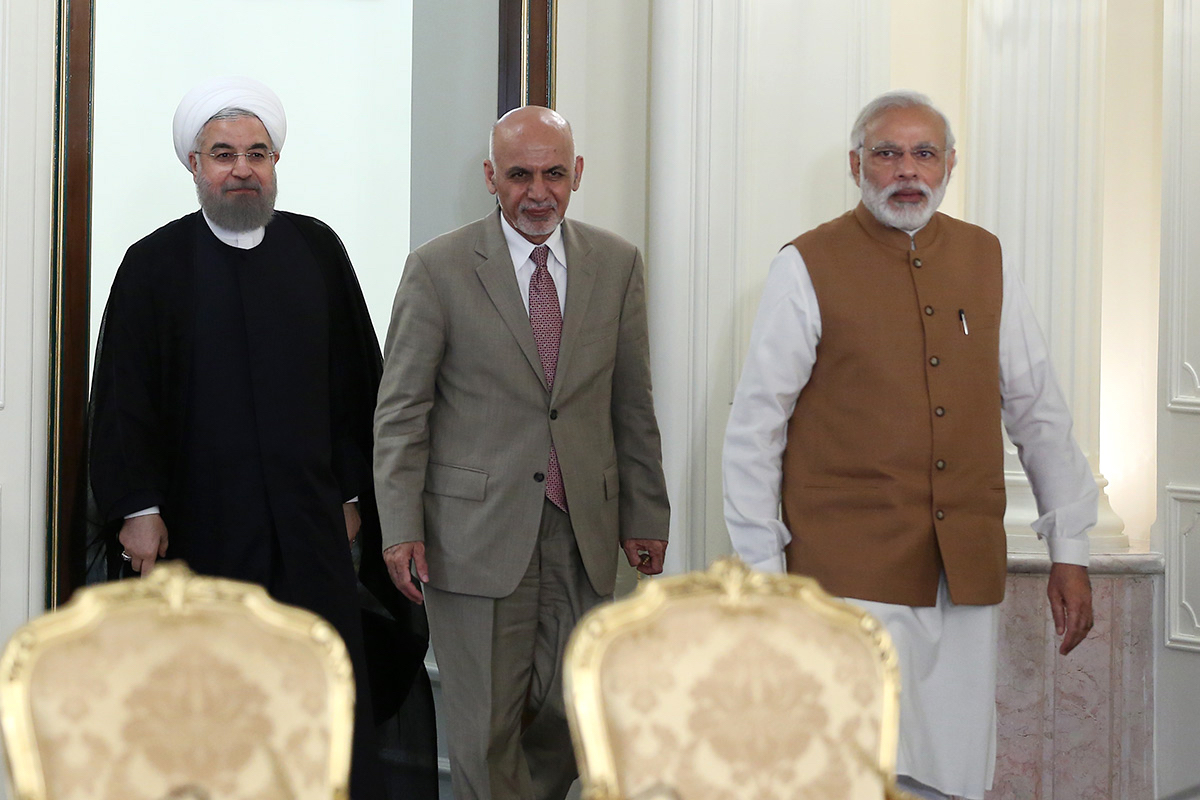 A handout picture provided by the office of Iranian President Hassan Rouhani on May 23, 2016, shows Rouhani (left) arriving for a press briefing with Indian Prime Minister Narendra Modi (right) and Afghan President Ashraf Ghani after signing a three-way transit agreement regarding Iran's southern Chabahar port. Photo: AFP / Iranian Presidential handout