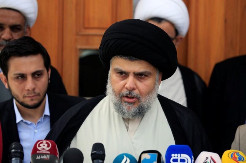 Iraqi Shiite cleric Moqtada al-Sadr speaks during a media conference with Iraqi Defense Minister Arfan al-Hayali and Iraq's Interior Minister Qasim al-Araji (not pictured) in Najaf, Iraq  May 3, 2017. Photo: Reuters/Alaa Al-Marjani