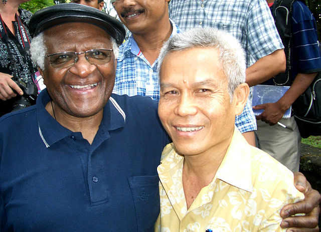 Sombath Somphone with Desmond Tutu in 2012.