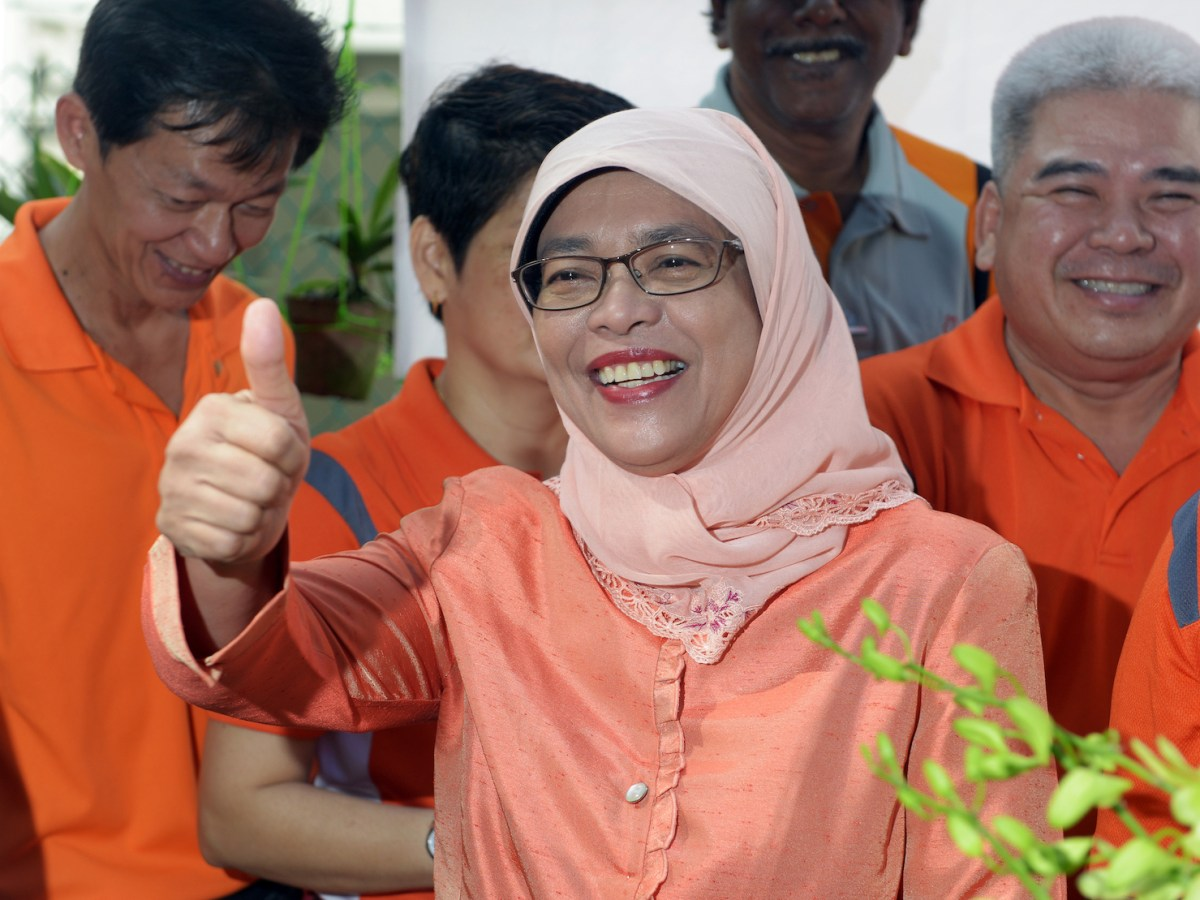 The Speaker of Parliament Halimah Yacob joins residents of her Marsiling ward at the launch of their Orchid and Edible Gardens cum Hari Raya celebration. Photo: AFP