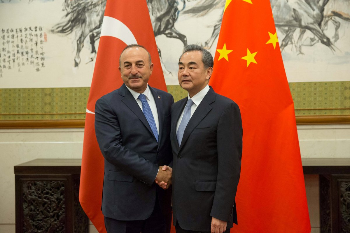 Chinese Foreign Minister Wang Yi (right) shakes hands with his Turkish counterpart Mevlut Cavusoglu during their meeting in Beijing on August 3, 2017. Photo: Reuters/Roman Pilipey/Pool
