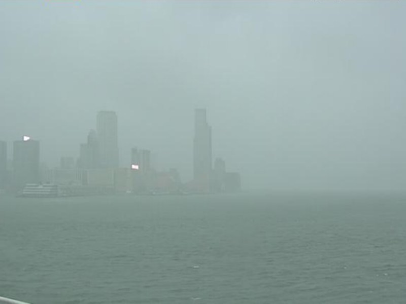 Central on Hong Kong Island is clouded by a dense mist of rain this morning as Typhoon Hato nears the city. Photo: HK Observatory