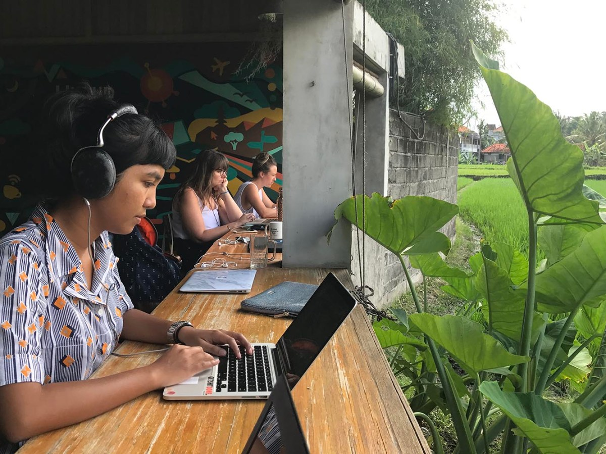Kintan Ayunda Wisnu, from Indonesia, types in the Hubud co-working space in the town of Ubud on Bali. The Indonesian island is becoming a hotspot for digital nomads. Photo: Christoph Sator/DPA