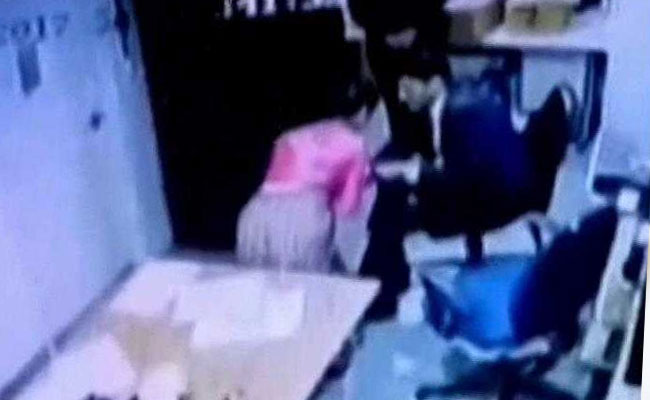 CCTV footage appears to show a Delhi Aerocity hotel staff member being pulled and molested. Photo: NDTV
