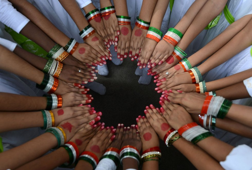 Schoolchildren wearing tricolor bangles pose in a circle during Indian Independence Day  celebrations in Secunderabad. Photo/AFP/Files