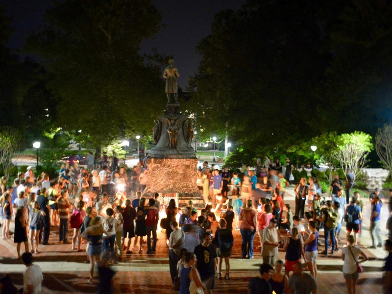 Charlottesville, Virginia, community members on August 16, 2017, leave candles and flowers at the base of a statue of Thomas Jefferson at a vigil for Heather Heyer. Photo: Reuters via Tim Dodson/The Cavalier Daily
