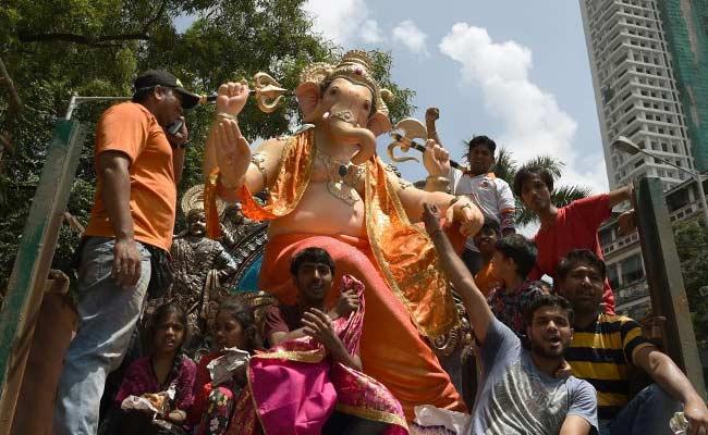 Mumbaikars prepare to celebrate Ganesh Chaturthi on Friday. Photo: NDTV