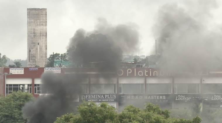 Smoke risies from an area near the Panchkula CBI court complex where Gurmeet Ram Rahim Singh was found guilty of rape. Photo: The Indian Express