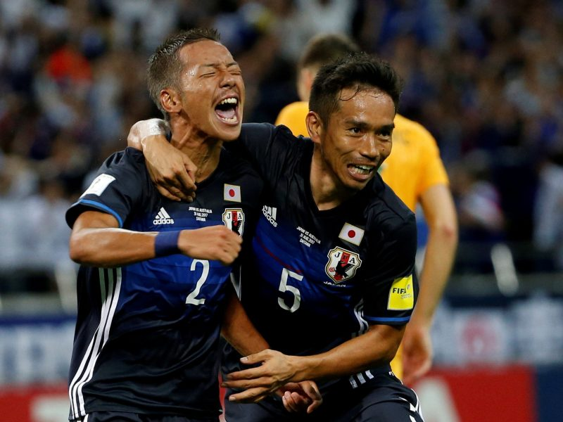 Japan's Ideguchi Yosuke (left) celebrates his goal with teammate Yuto Nagatomo. Photo: Reuters / Toru Hanai