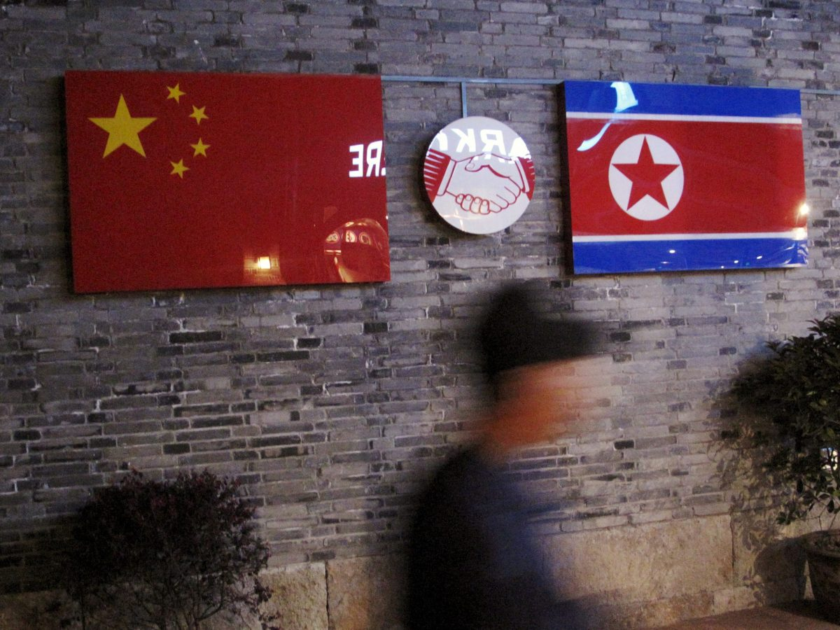 Flags of China and North Korea are seen outside the closed Ryugyong Korean Restaurant in Ningbo, Zhejiang province, China. Photo: Reuters/Joseph Campbell