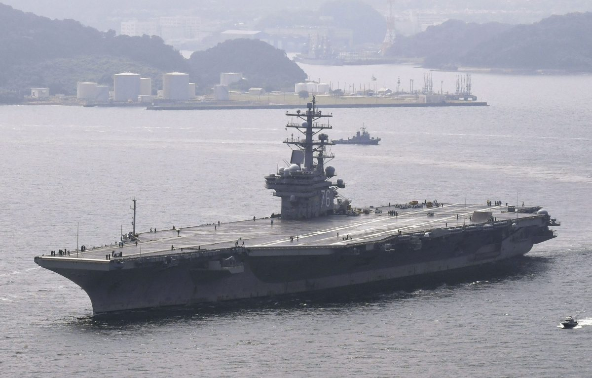USS Ronald Reagan, a Nimitz-class nuclear-powered supercarrier, leaves from its home port in Yokosuka, south of Tokyo. Kyodo via Reuters