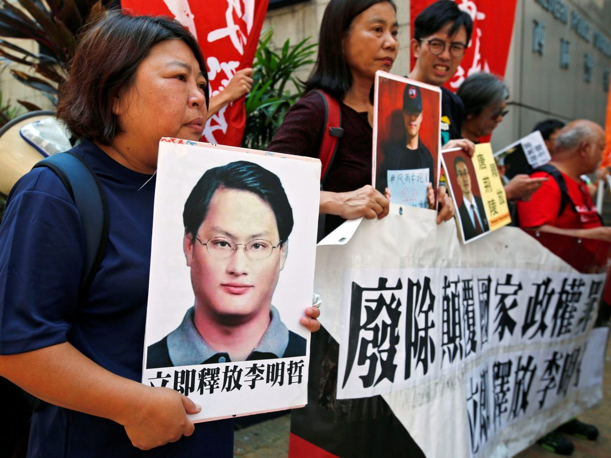 Pro-democracy protesters carry a photo of detained Taiwanese rights activist Lee Ming-Che (left) and other activists during a demonstration in Hong Kong, China, September 11, 2017. Photo: Reuters / Bobby Yip