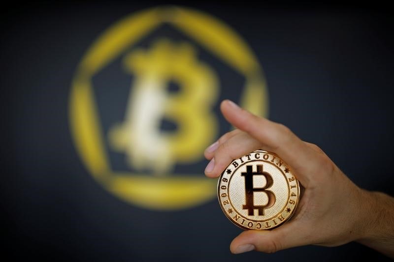 Bitcoin is only the best known of the many digital currencies vying for attention. Photo: Reuters / Benoit Tessier / Illustration