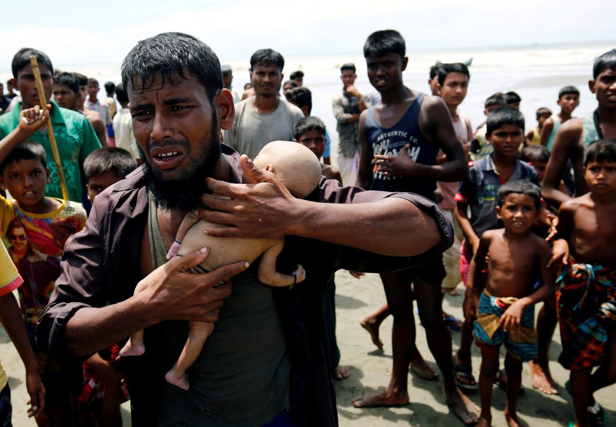 Nasir Ahmed, a Rohingya refugee, cries as he holds his 40-day-old son, who died as a boat capsized in the shore of Shah Porir Dwip while crossing the Bangladesh-Myanmar border, in Teknaf, Bangladesh, September 14, 2017. Reuters/Mohammad Ponir Hossain