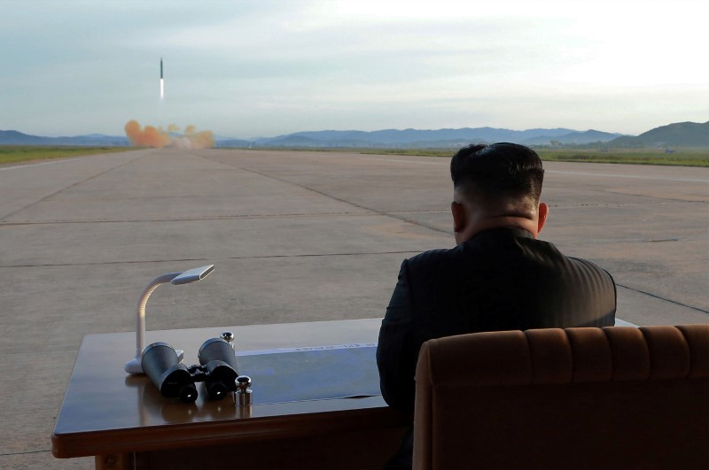 North Korean leader Kim Jong-un watches the launch of a Hwasong-12 missile, Septembeer 16, 2017. Photo: KCNA via Reuters