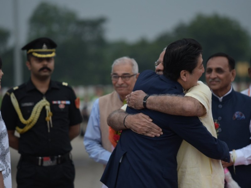 Indian Prime MInister Narandra Modi greeted his Japannese counterpart Shinzo Abe with a bear hug upon his arrival in Ahmedabad, India.  Photo: Indian Ministry of External Affairs Twitter account