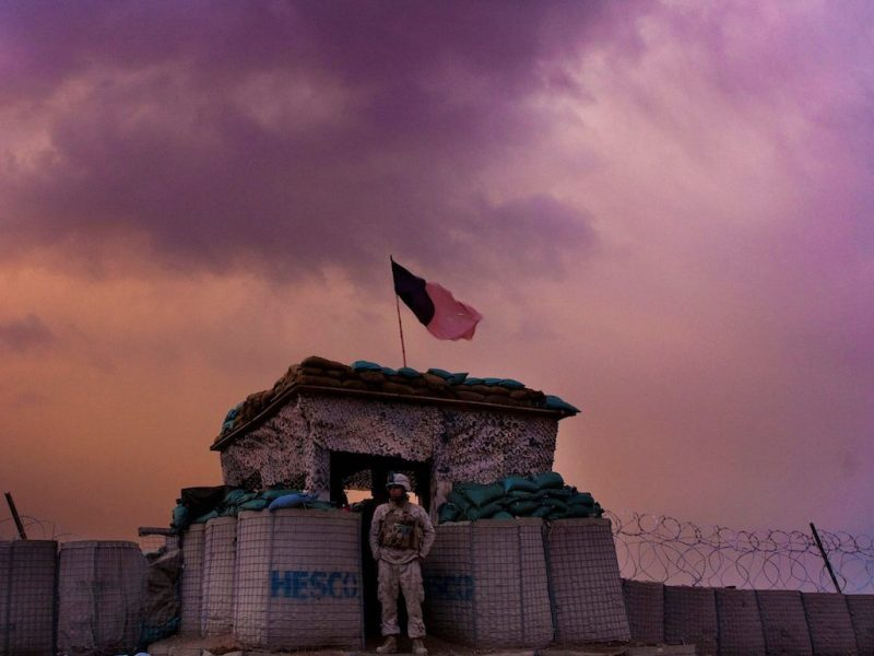 A US marine looks out as an evening storm gathers above an outpost near Kunjak in southern Afghanistan's Helmand province on February 22, 2011. Picture taken February 22, 2011. REUTERS/Finbarr O'Reilly